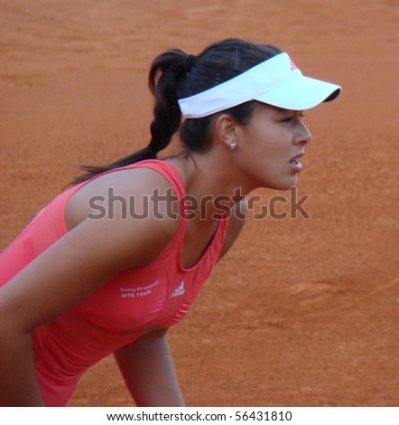 BERLIN - MAY 11:  Ana Ivanovic of Serbia preparing to return a serve during a match in the Berlin Open 2008 on May 11, 2008. - stock photo