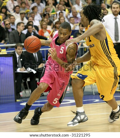 BERLIN-MAY 31:Bonn's Winsome Frazier in action against Berlin's Wright during 1st  basketball playoff half final match - Alba Berlin vs Telekom Baskets Bonn (71:73) at O2World May 31, 2009 in Berlin.