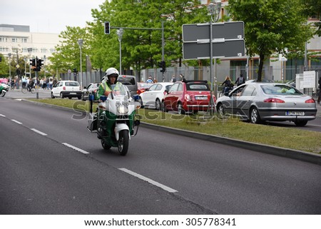 BERLIN - MAY 22: Convoy of protected vehicles transporting Sri Lanka Secreetary of State Mangala Samaraweera in Berlin streets on May 22, 2015 in Berlin Germany.
