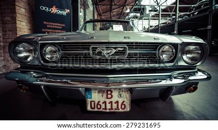BERLIN - MAY 10, 2015: Pony car Ford Mustang (first generation).  Stylization. Toning. 28th Berlin-Brandenburg Oldtimer Day - stock photo