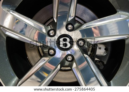 BERLIN - MAY 02, 2015: Showroom. Wheels and braking system components of a full-size luxury car Bentley Mulsanne Speed. Produced since 2014. - stock photo