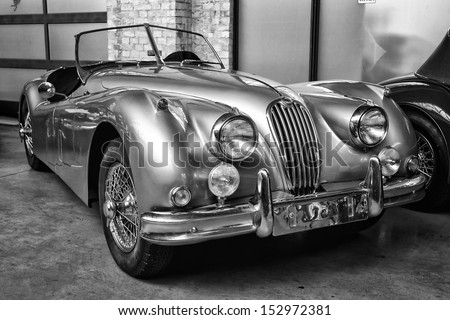 BERLIN - MAY 11: Sport car Jaguar XK140 Roadster, (black and white), 26th Oldtimer-Tage Berlin-Brandenburg, May 11, 2013 Berlin, Germany - stock photo