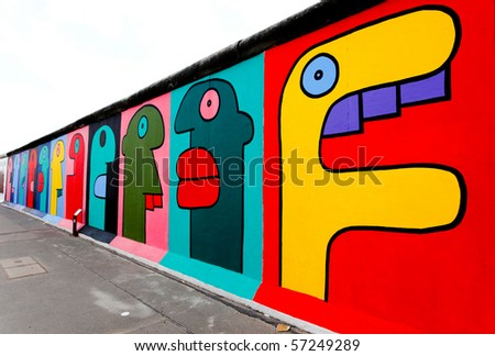 BERLIN - MAY 29: The East Side Gallery - the largest outdoor art gallery in the world on a segment of the Berlin Wall May 29, 2010 in Berlin. - stock photo