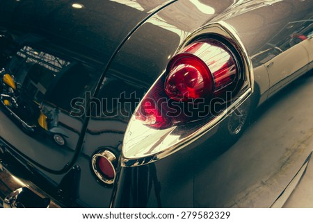 BERLIN - MAY 10, 2015: The rear brake lights vintage car Facel Vega FV4 Typhoon, 1958. Stylization. Toning. 28th Berlin-Brandenburg Oldtimer Day