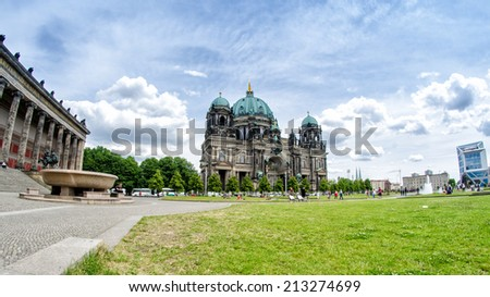 BERLIN - MAY 27, 2012: Tourists walk along Berliner Dom on a beautiful day. More than 25 million people visit the city every year.
