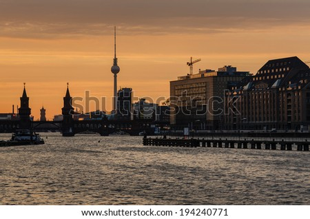 Berlin oberbaumbrucke with tv tower at sunset, Germany - stock photo