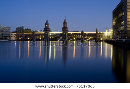 berlin oberbaumbruecke bridge by night - stock photo