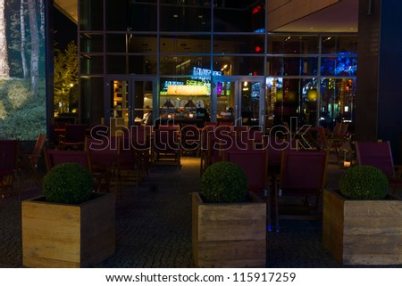 "BERLIN - OCTOBER 13: Cafe near Potsdamer Platz and beautiful reflection, ""Festival of Light"", October 13, 2012 in Berlin, Germany"