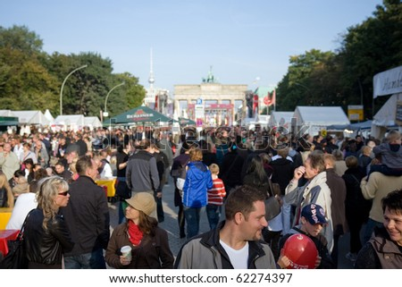 BERLIN-OCTOBER 3 : Thousands of people celebrate the 20th anniversary of unification of eastern and western Germany Oct 3, 2010 in Berlin. - stock photo