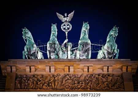 berlin - quadriga statue. Detail of the statue at the top of the brandenburg gate in berlin at night. Main symbol of Berlin. - stock photo