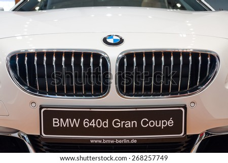 BERLIN - SEPTEMBER 09, 2012: Showroom. Detail of a Grand tourer / executive coupe BMW 640i Gran Coupe (F06) close-up. Produced since 2012. - stock photo