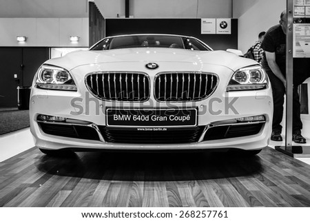 BERLIN - SEPTEMBER 09, 2012: Showroom. Grand tourer / executive coupe BMW 640i Gran Coupe (F06). Black and white. Produced since 2012. - stock photo
