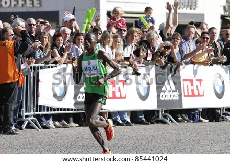 BERLIN - SEPTEMBER 25: Winner of the thirty-eighth Berlin Marathon, Patrick Makau,shortly before the finish line on September 25, 2011 in Berlin, Germany.