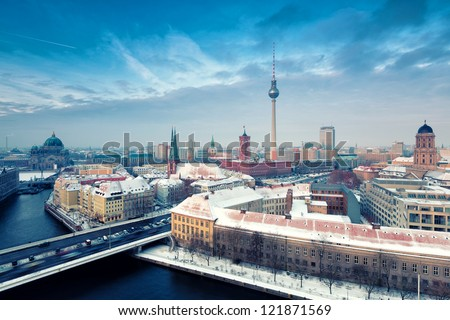 Berlin Skyline Winter City Panorama with snow and blue sky - famous landmark in Berlin, Germany, Europe - stock photo