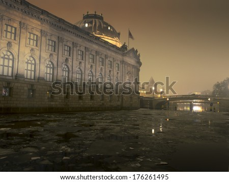Berlin winter night scenery with famous Bode museum and cracked ice blocks in Spree river - stock photo