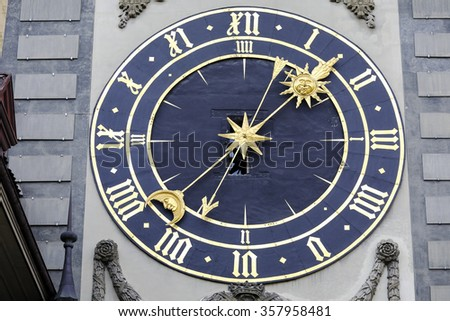 BERN, SWITZERLAND - DECEMBER 22, 2015: Massive clockface of Zytglogge, its general layout is dated back to 1770. It is on the first western gate of the city (1191 - 1256), famous tourist attraction - stock photo