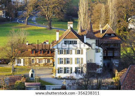 BERN, SWITZERLAND - DECEMBER 25, 2015: Wittigkofen Palace, its history began hundreds of years ago, placed at Murifeld, was originally built as a residence for a farm  - stock photo