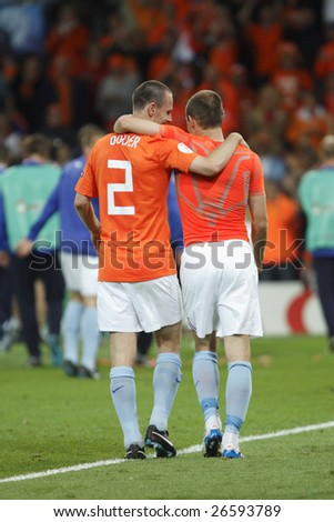 BERN, SWITZERLAND - JUNE 13:  Andre Ooijer (l) and Arjen Robben (r) celebrate after Holland's 4-1 victory over France in a UEFA Euro 2008 match June 13, 2008 in Bern, Switzerland.
