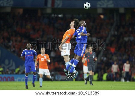 BERN, SWITZERLAND - JUNE 13:  Ruud van Nistelrooy of Holland (L) jumps for a header against William Gallas of France (R) during a Euro 2008 match on June 13, 2008 in Bern, Switzerland.  Editorial only - stock photo