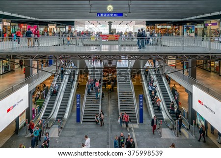 BERN, SWITZERLAND - MAY 10, 2014: Commuter in the main train stations in Bern.