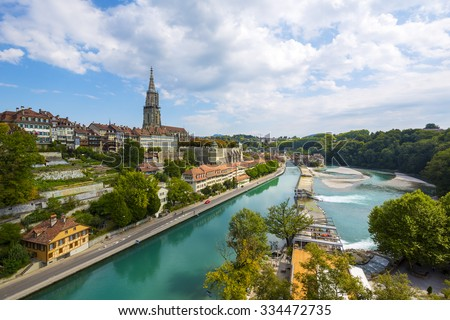 BERN, SWITZERLAND - SEPTEMBER 11, 2015: General view of Bern and the steeple of the cathedral towering over the city. The Capital City of Switzerland it is the 4th most populous city in Switzerland - stock photo