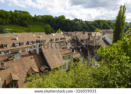 BERN, SWITZERLAND - SEPTEMBER 06, 2015: Roofs of the townhouses of the city. Bern with a population of approx. 140000 citizens it is the fourth most populous city in Switzerland