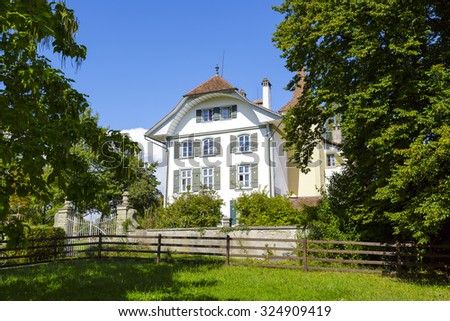 BERN, SWITZERLAND - SEPTEMBER 14, 2015: Wittigkofen Palace, its history began hundreds of years ago, placed near Murifeld, fire destroyed a part of the building in 1580 was rebuilt in a new form