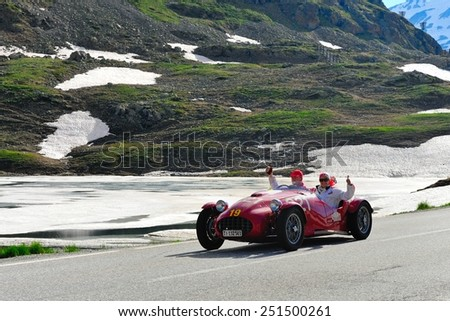 BERNINA PASS, SWITZERLAND - JUNE 14: A red Ermini 1100 Sport Siluro takes part to the Summer Marathon classic car race on June 14, 2014 at Bernina Pass. This car was built in 1951 - stock photo