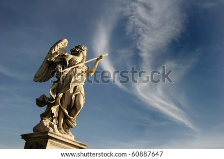 Bernini's marble statue of angel against the background of sky on Sant'Angelo Bridge in Rome - stock photo