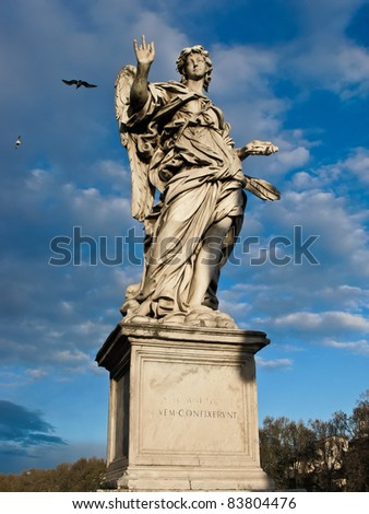 Bernini's marble statue of angel from the Sant'Angelo Bridge in Rome, Italy - stock photo