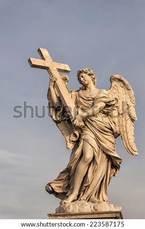 Bernini's marble statue of angel with cross, Saint Angelo Bridge in Rome, Italy. - stock photo