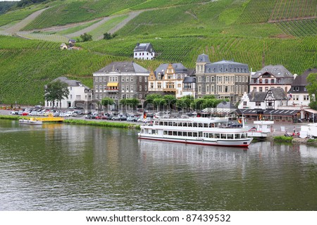 Bernkastel-Kues - town in Rhineland-Palatinate region of Germany. Old decorative houses and vineyards next to Mosel river. - stock photo