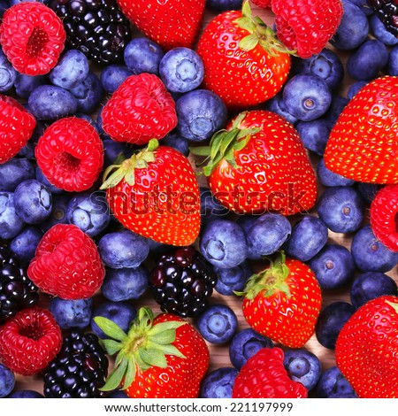 Berries Background. Strawberries, Blueberry, Raspberries, and Blackberry. - stock photo