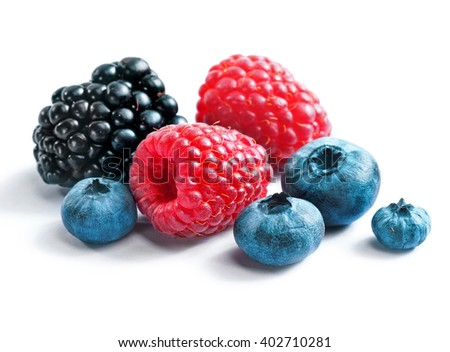 Berries blackberies, blueberries and raspberries on white background. Close up, top view, high resolution product. Harvest Concept - stock photo