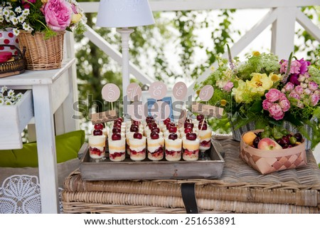 Berries desserts with cream and biscuits in glasses