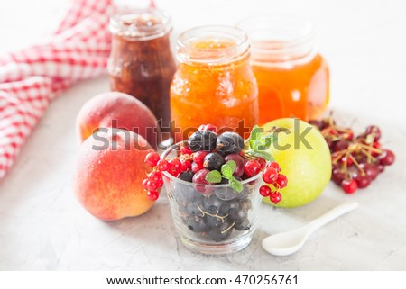 berries, fruit and jam on a table, selective focus