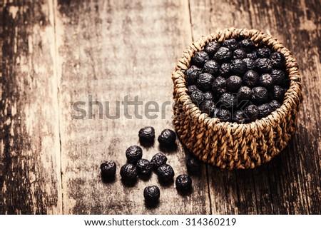berries in basket on wooden vintage table,healthy food. - stock photo
