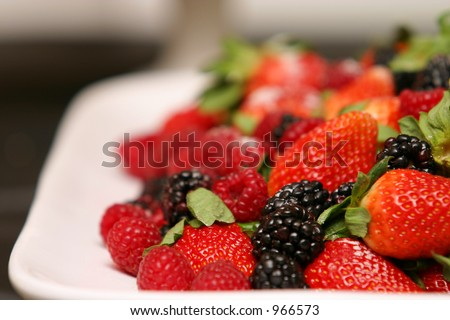 Berries on platter - stock photo