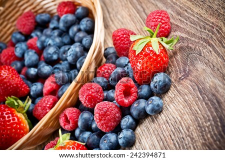 Berries on wooden background - stock photo