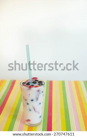 Berries with milk - stock photo