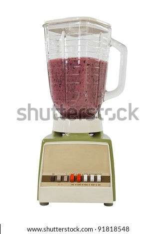 Berry banana smoothie in vintage blender, isolated on white. - stock photo