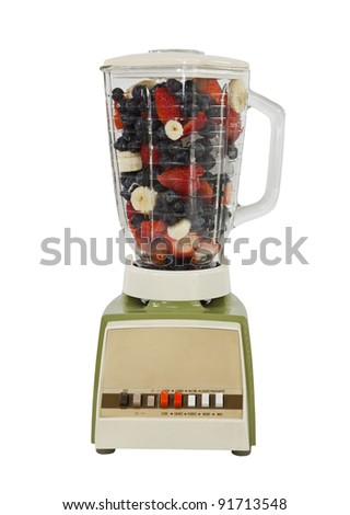 Berry banana smoothie mix in vintage blender, isolated on white. - stock photo