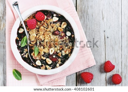 Berry crumble. Clean-eating gluten free dessert . Superfoods concept.Toned image, selective focus. - stock photo