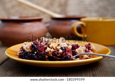Berry crumble on a plate - stock photo