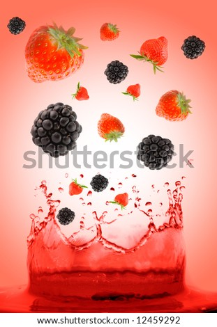 berry falling in juice. - stock photo