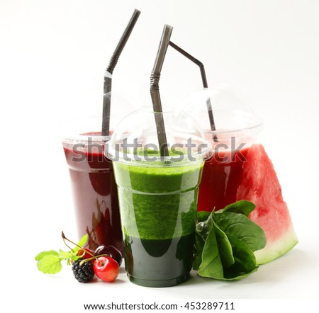 berry fruit and spinach drink smoothies with cherries, raspberry and watermelon - healthy food  - stock photo