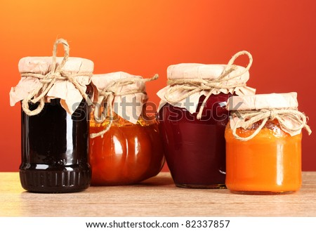 berry jam on a wooden background - stock photo