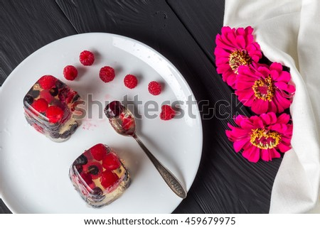 Berry jelly on plate and flowers top view