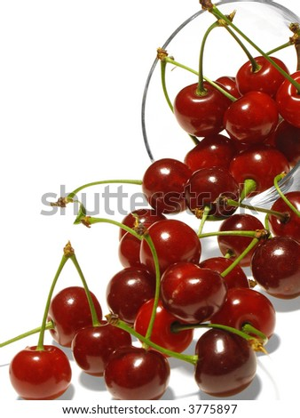 Berry of cherry was scattered from  vase.