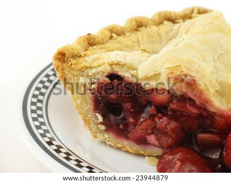 berry pie on a white and black checkered plate on white
